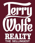 Terry Wolfe Realty Logo